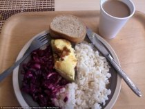Lunch in an Estonian school is rice with a piece of meat and purple cabbage. They also have bread and a get a cup of chocolate drink